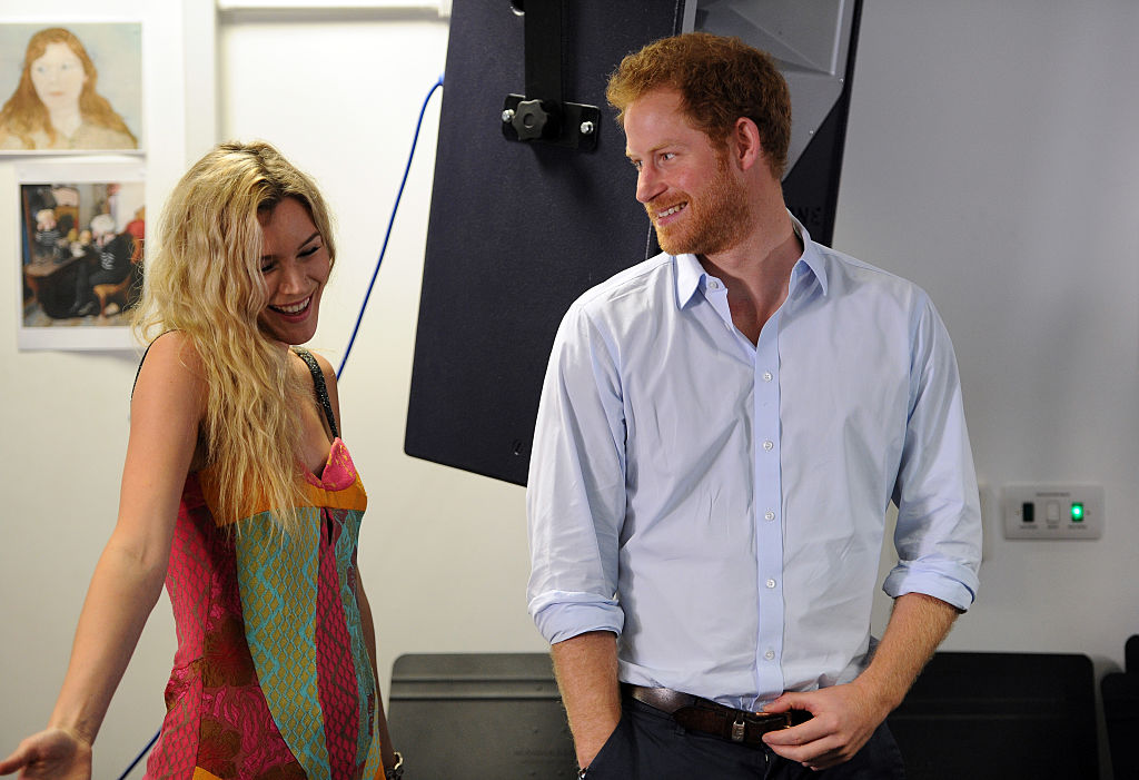 Joss Stone and Prince Harry watch members of the Basotho Youth Choir during their rehearsals at the Brit School