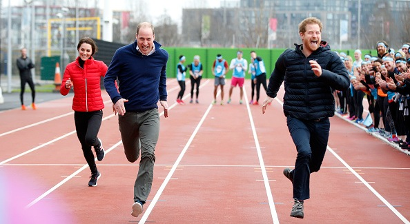 Britain's Catherine, Duchess of Cambridge (L), Britain's Prince William, Duke of Cambridge (C) and Britain's Prince Harry (R) take part in a relay race, during a training event