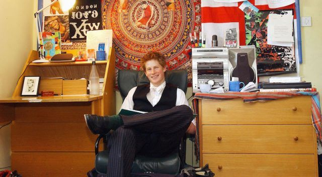 Prince Harry sits in a dorm room in Eaton College.
