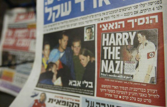 A newspaper with Prince Harry's photo and story.