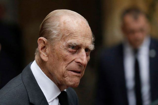 Prince Phillip in a grey suit and tie.