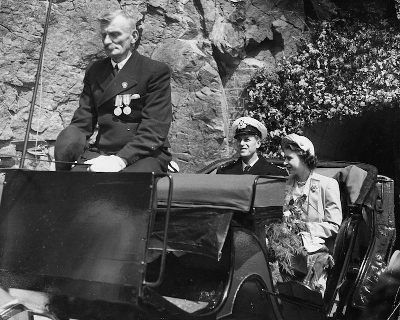 Princess Elizabeth and Prince Philip, the Duke of Edinburgh, riding in a carriage at they tour the island of Sark, Guernsey, circa 1948.