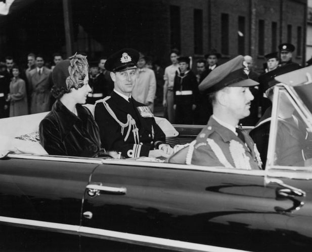 Princess Elizabeth and Prince Charles riding backseat in a car.