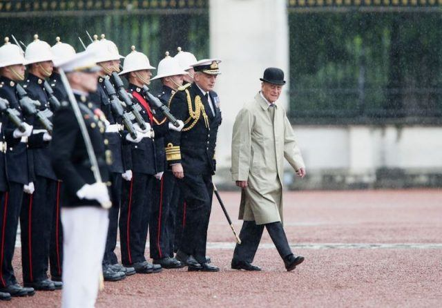 Prince Charles leading a march in front of soldiers.