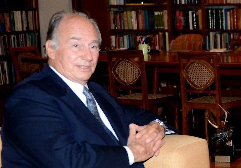 Prince Shah Karim Al Husseini sits in a chair