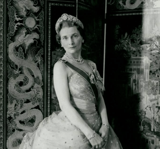 Princess Alice in a gown and a sash.