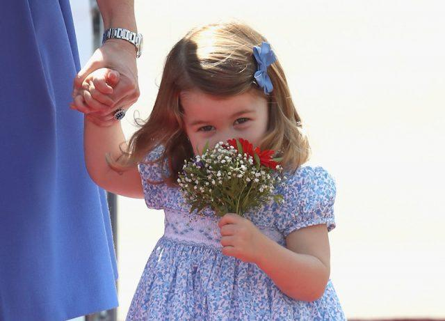 Princess Charlotte holding a small bouquet of flowers.