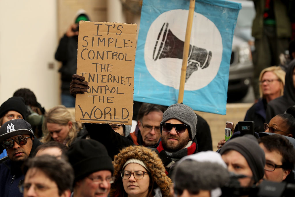 Demonstrators rally outside the Federal Communication Commission building to protest against the end of net neutrality rules