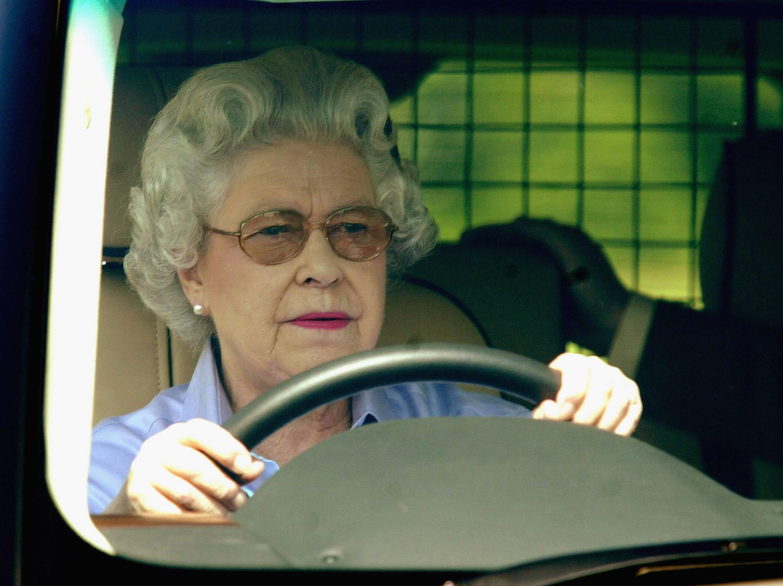 Queen Elizabeth driving her SUV