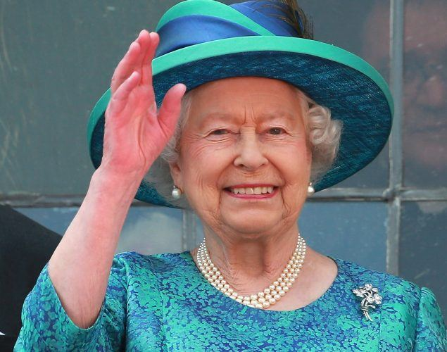 Queen Elizabeth II Visits Frankfurt in a blue dress, hat and white pearls.