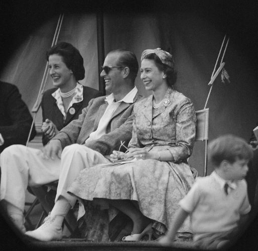 Princess Elizabeth smiles as she sits next to Prince Philip.