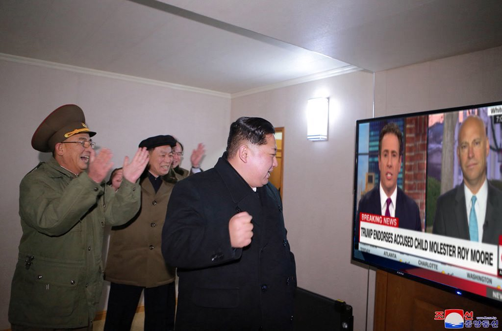 Kim Jong Un in front of a tv
