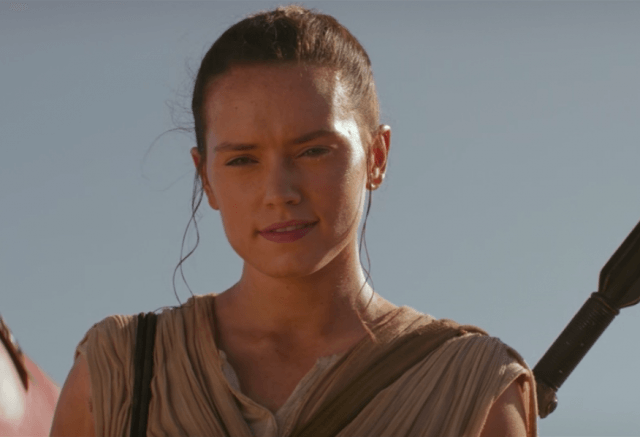 Rey stands in the sunlight.