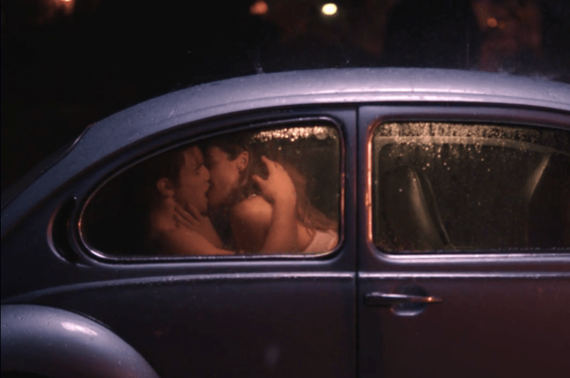 Archie and Ms. Grundy kissing in the backseat of a car.