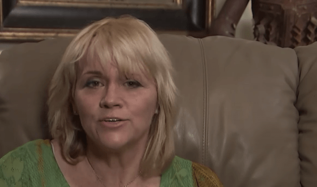 Samantha Markle sits on a couch during a televised interview.