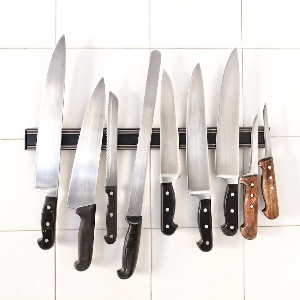 Set of knives on magnetic holder