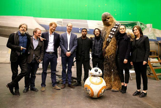 The Star Wars cast posing together on set.