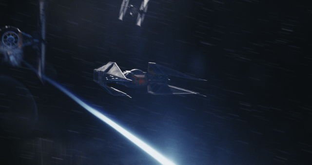 Three ships flying through space.