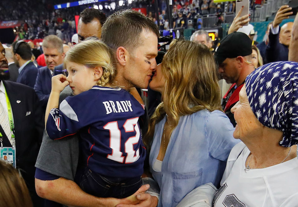 Tom Brady #12 of the New England Patriots celebrates with wife Gisele Bundchen and daughter Vivian Brady