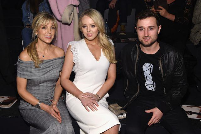 Marla Maples, Tiffany Trump and Ross Mechanic sit together at a fashion show.