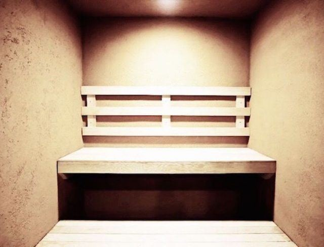 A steam room with a built in bench.