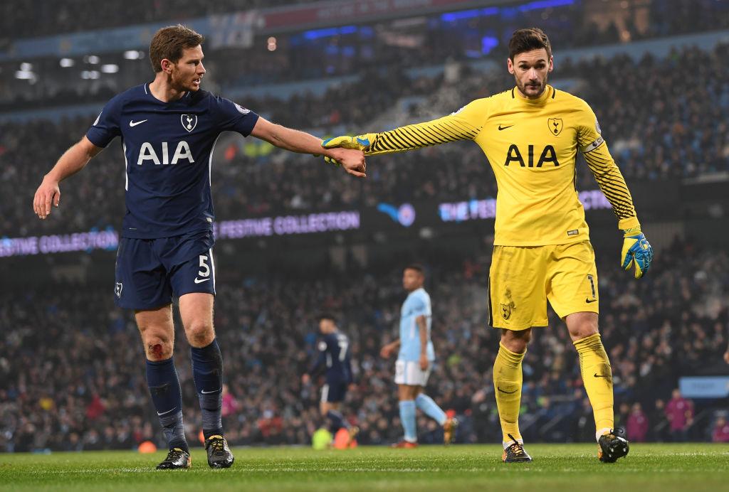 Tottenham Hotspur players touching hands