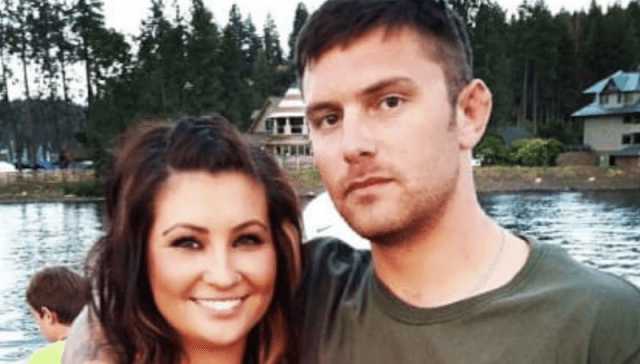 Track Palin posing with his girlfriend in front of a lake.