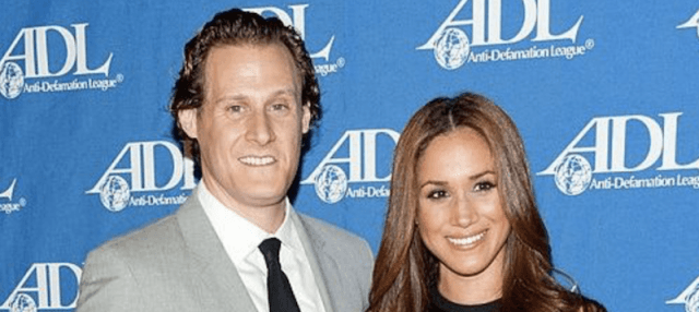 Trevor Engelson and Meghan Markle on a red carpet.