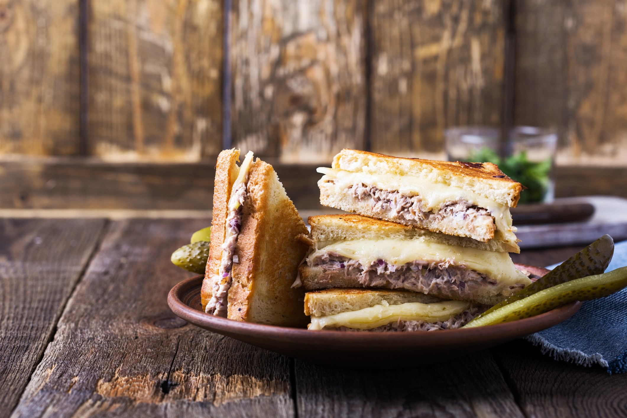 Homemade tuna melt sandwich on rural table