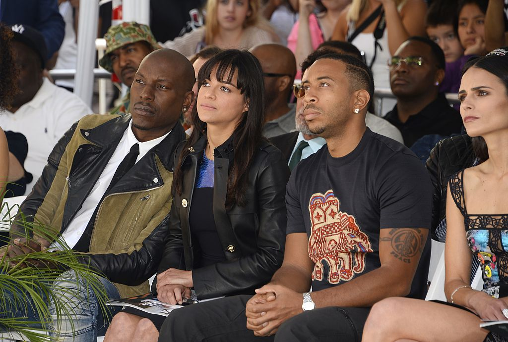 Co-stars Tyrese Gibson, Michelle Rodriguez, and Ludacris listen as actor Vin Diesel (not in photo) speaks about his friend Paul Walker.