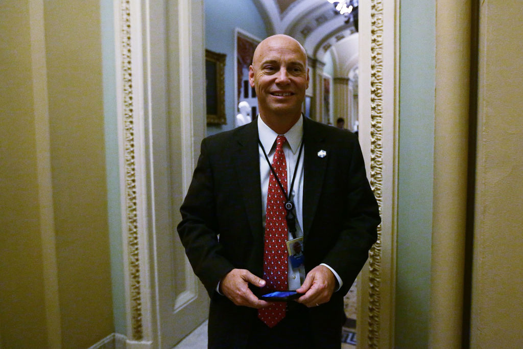 White House Director of Legislative Affairs Marc Short passes by in a hallway at the Capitol
