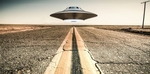 A UFO seen down a road.