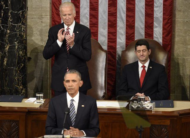 Barack Obama speaks as House Speaker Paul Ryan gestures and Joe Biden claps during the State of the Union Address