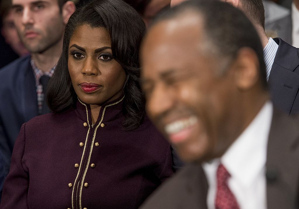 Omarosa Manigault sits near Ben Carson as he arrives to testify during his confirmation hearing