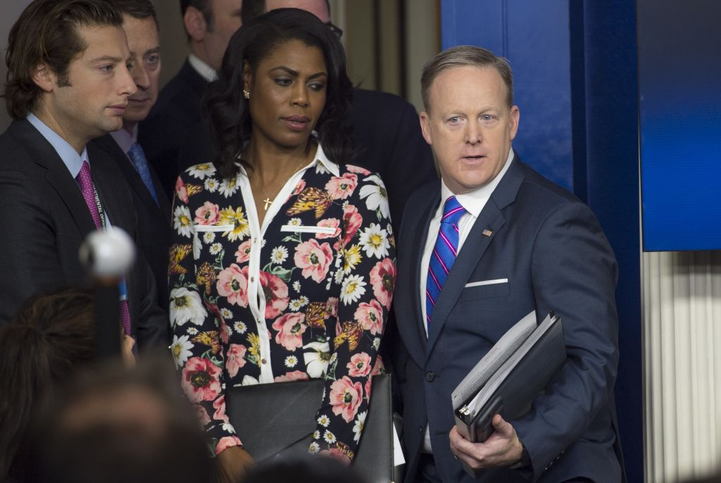 White House Press Secretary Sean Spicer (R) arrives alongside Omarosa Manigault for the daily press briefing at the White House
