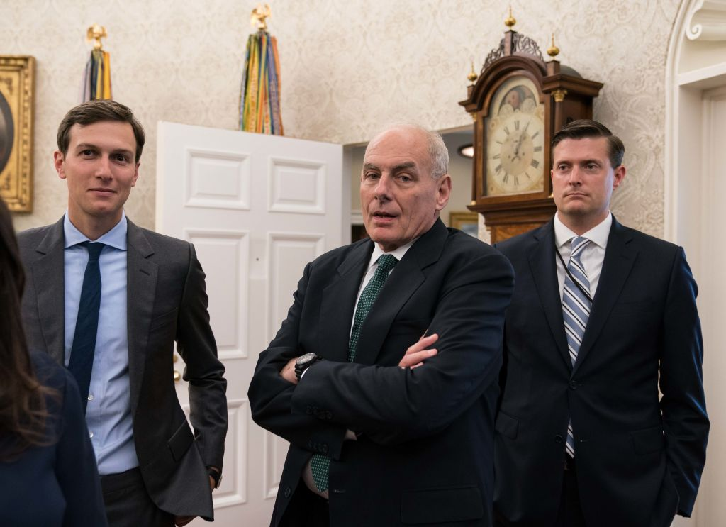 White House senior adviser Jared Kushner (L), chief of staff John Kelly (C) and staf secretary Rob Porter look on after US President Donald Trump signed a proclamation
