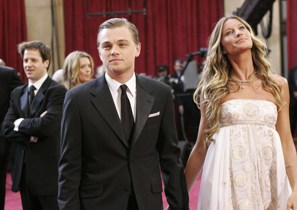 Leonardo DiCaprio and his girlfriend Brazilian model Gisele Bündchen arrive at the 77th Academy Awards.