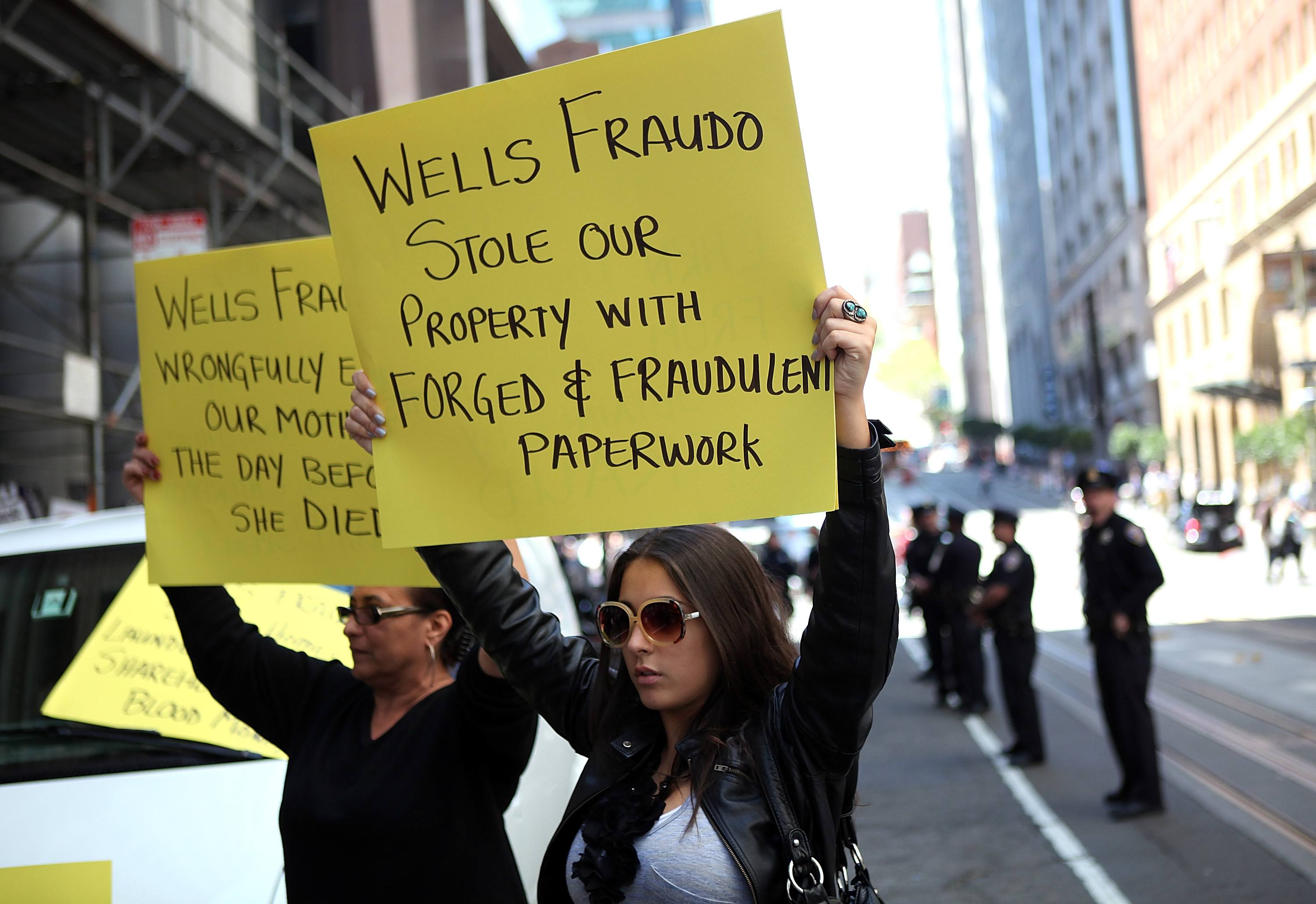 Activists Protest Outside Wells Fargo Shareholders Meeting In San Francisco