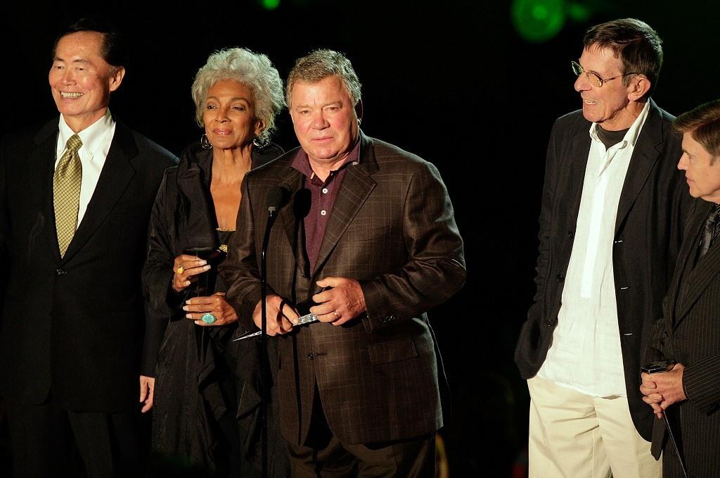 Actors George Takei, Nichelle Nichols, William Shatner, Leonard Nimoy and Walter Koenig accept an award.