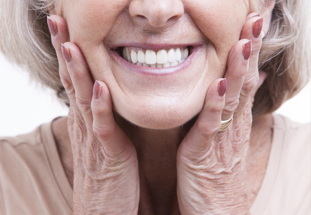 Woman smiling with dentures
