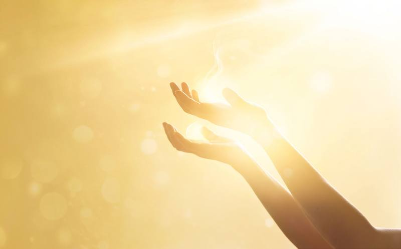 woman's hands holding sunlight