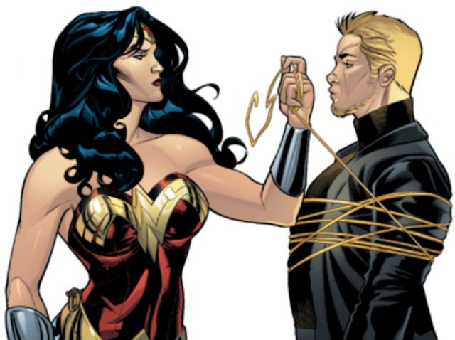 Wonder Woman seen tying Nemesis with a gold string.