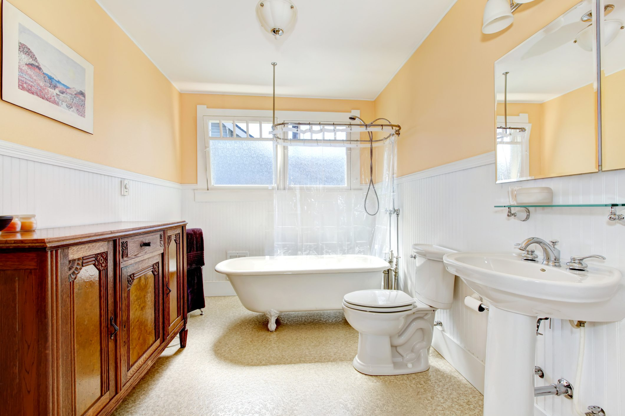 Yellow bathroom with claw foot tub