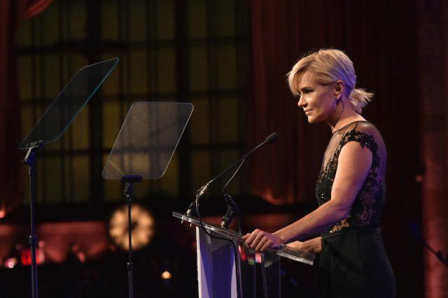 Yolanda Foster making a speech at a podium.