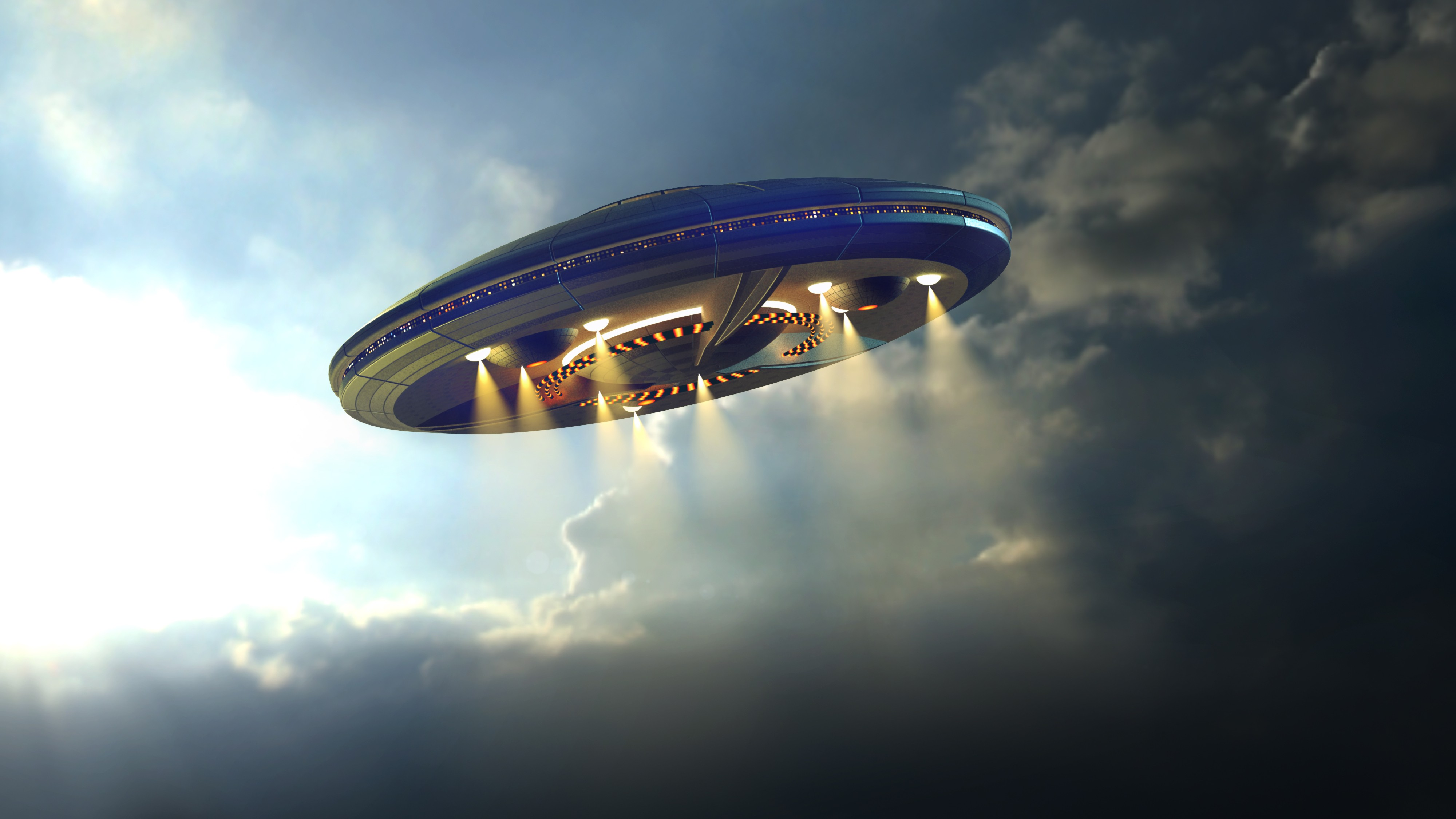 Alien UFO saucer flying on a clouds background above Earth