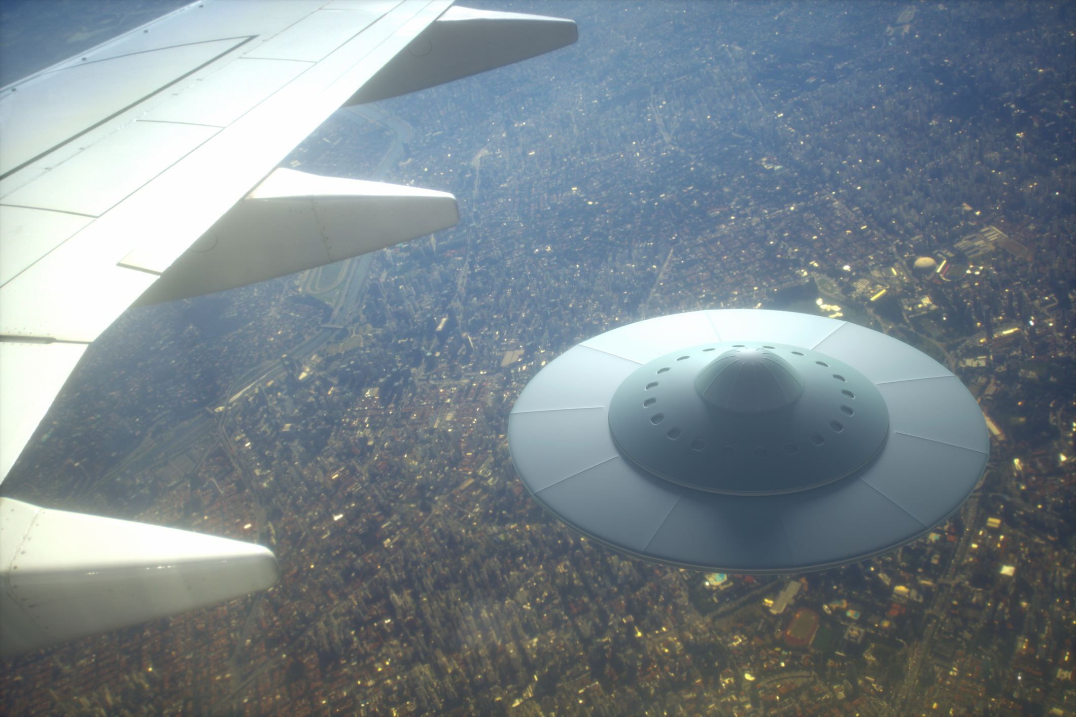 UFO flying below plane's wing
