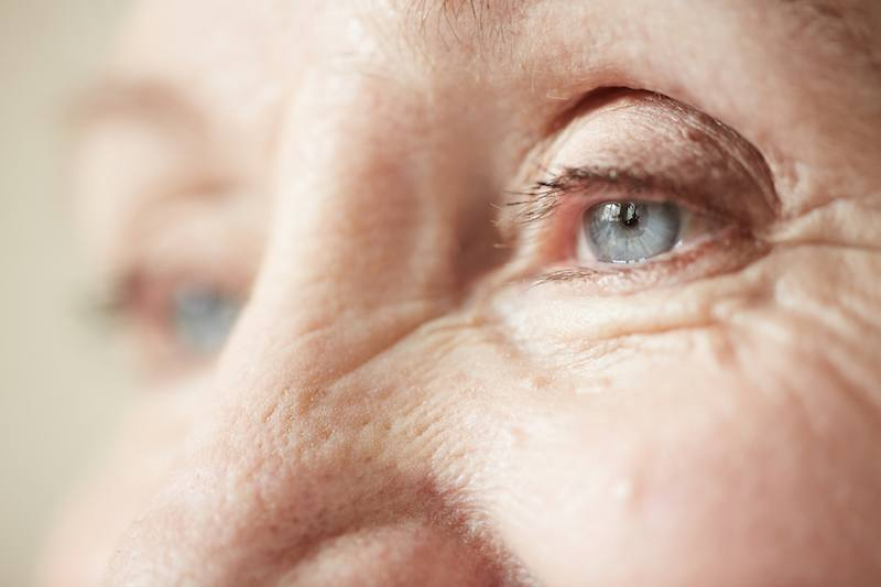 A close-up of an older woman's face
