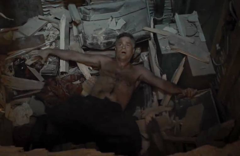 Bruce Banner lays in a pile of debris