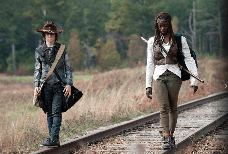 Carl and Michonne walk side by side