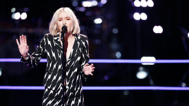 Chloe Kohanski performing her song on stage.